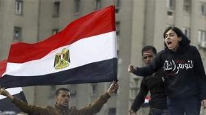 Protesters opposing Egyptian President Mohamed Morsi shout slogans at Tahrir Square in Cairo.