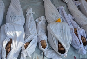 Bodies of people activists say were killed by nerve gas in the Ghouta region are seen in the Duma neighbourhood of Damascus