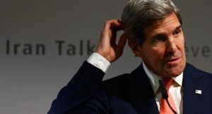 U.S. Secretary of State John Kerry gestures during a news conference after nuclear talks in Geneva