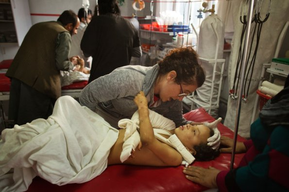 Georgia Novello, a nurse in Kabul, comforted an 8-year-old girl wounded, along with her mother, in an airstrike in Kunduz. Credit Victor J. Blue for The New York Times